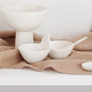 Double bowl sauce and spoon in a shiny ivory finish. Organic handcrafted tableware