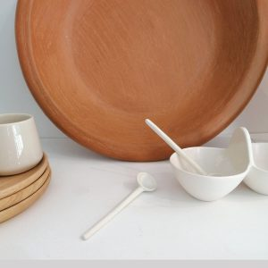 Small double bowl sauce with spoon, shiny ivory. Redwoods shop online.
